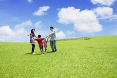 Parents plays with their children in park Stock Images