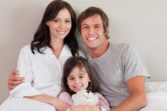 Parents posing with their daughter Royalty Free Stock Photography