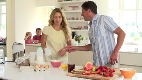 Parents Preparing Family Breakfast In Kitchen stock video footage