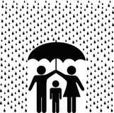 Parents protect child with umbrella in rain. A couple of parents protect a child from a rain storm of risk with a secure safety umbrella Royalty Free Stock Image