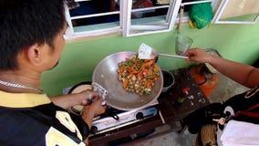 Parents of public elementary school children saut`e vegetables during the nutritional cooking meet. San Pablo City, Laguna, Philippines - August 2, 2015: Parents stock video
