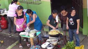 Parents of public elementary school children saut`e vegetables during the nutritional cooking meet. San Pablo City, Laguna, Philippines - August 2, 2015: Parents stock video footage