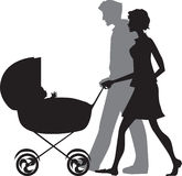 Parents Pushing Cart Stock Image