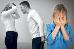 Parents quarreling. Parents quarreling at home, child is crying Royalty Free Stock Photo