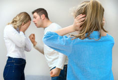 Parents quarreling. Parents quarreling at home, child in shock Stock Image