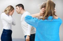 Parents quarreling. Parents quarreling at home, child in shock Stock Photo