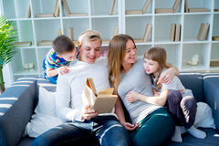 Parents reading book stock photos