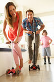 Parents Riding Childrens Scooters Stock Photo