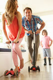 Parents Riding Childrens Scooters Royalty Free Stock Photos
