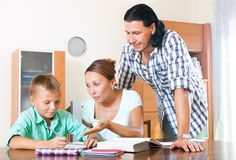 Parents with schoolboy doing homework Royalty Free Stock Image