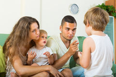 Parents scolding child in home royalty free stock image