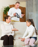 Parents scolding daughter at home royalty free stock photos