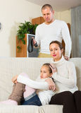 Parents scolding daughter at home Royalty Free Stock Photo