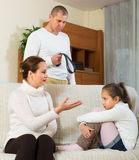 Parents scolding daughter at home Stock Photo