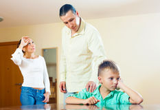 Parents scolding  son in home. Royalty Free Stock Photo