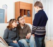 Parents scolding teenage boy Stock Photography