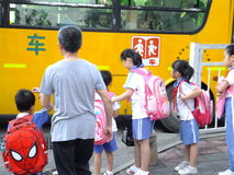Parents send their children to school bus Stock Image