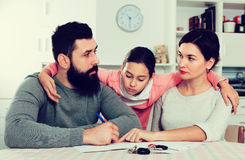 Parents signing papers for divorce Stock Photos