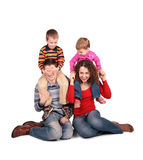 Parents sit with children on shoulders Royalty Free Stock Photography