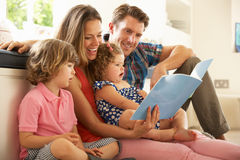 Parents Sitting With Children. Reading Story Indoors Royalty Free Stock Photography