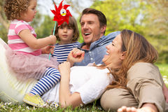 Parents Sitting With Children In Field Stock Photos