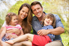 Parents Sitting With Children In Field Royalty Free Stock Image