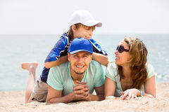 Parents with smiling boy in vacation Royalty Free Stock Photography