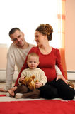 Parents with the son. Happy parents with the son at home Stock Images