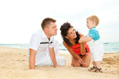 Parents with son at beach Royalty Free Stock Image