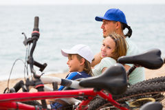 Parents and son with bicycles Royalty Free Stock Photography