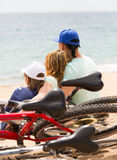Parents and son with bicycles Royalty Free Stock Photo