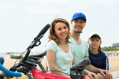 Parents and son with bicycles Royalty Free Stock Images