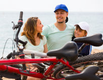 Parents and son with bicycles Stock Photo