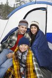 Parents With Son Camping Together. Portrait of happy parents with son camping together in winter Stock Image