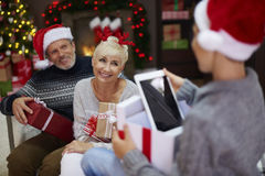 Parents with son during Christmas Stock Image