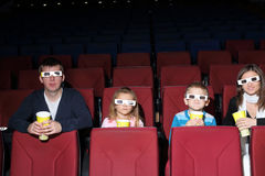 Parents with son and daughter in 3D glasses Stock Image