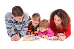 Parents with son and daughter look books Stock Photos