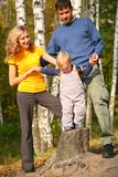 Parents with son in forest in autumn Stock Images