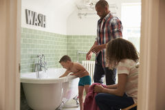 Parents And Son Having Fun At Bath Time Together Stock Photography