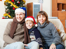 Parents with  son posing for  Christmas portrait Stock Images