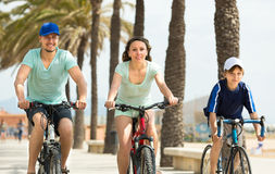 Parents with  son spending a weekend with bicycles Royalty Free Stock Image