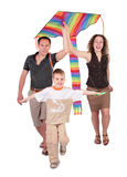 Parents and son start kite. On white stock photography