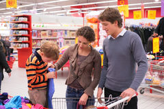 Parents with son in supermarket Stock Photo