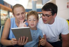 Parents and son with tablet PC at the airport Stock Image