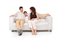 Parents with son on white leather sofa Royalty Free Stock Images