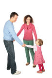 Parents stand having joined hands with daughter stock photography