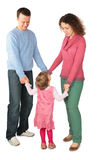 Parents stand having joined hands with daughter Stock Images