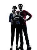 Parents standing  with baby silhouette Stock Images