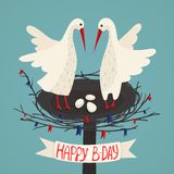 Parents Storks and Eggs in Nest Birthday Card Stock Photography
