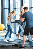 Parents supporting daughter workout on treadmill Royalty Free Stock Photography